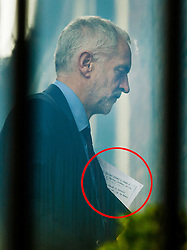 © Licensed to London News Pictures. 24/06/2016. London, UK. Labour Party Leader Jeremy Corbyn walks back to his office after attending a shadow cabinet meeteing carrying notes (circled in red). Two Labour MPs have submitted a motion of no confidence in Mr Corbyn. Prime Minister David Cameron has resigned after the UK EU referendum result was announced with a victory for the leave campaign. Photo credit: Peter Macdiarmid/LNP