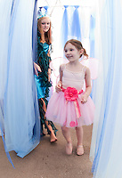 """Ayla Malenda is taken through the waves by the """"Water Fairy"""" during Cackleberries annual Fairy Princess Night in Meredith Wednesday evening.   (Karen Bobotas/for the Laconia Daily Sun)"""