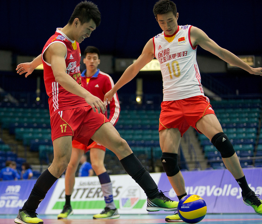 Junhuang Ke (17) and Daoshuai Ji (10) of China warm up prior to playing Canada at a World League Volleyball match at the Sasktel Centre in Saskatoon, Saskatchewan Canada on June 25, 2016.