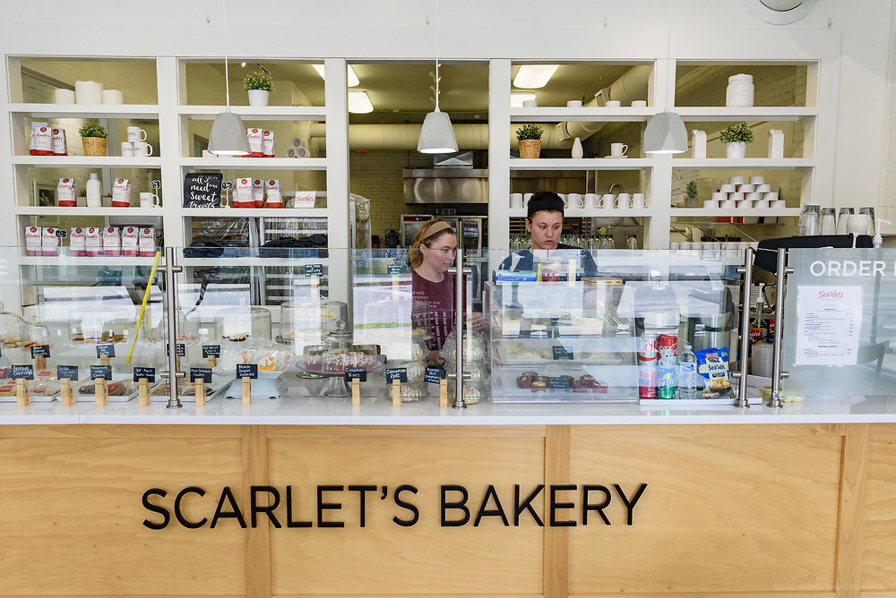 Robin Thomas, shift manager, and Ashley Haire, baker-in-training, close the store at Scarlet's Bakery, 741 E. Oak, at the corner of Oak and Shelby Streets in the Smoketown neighborhood. April 18, 2018