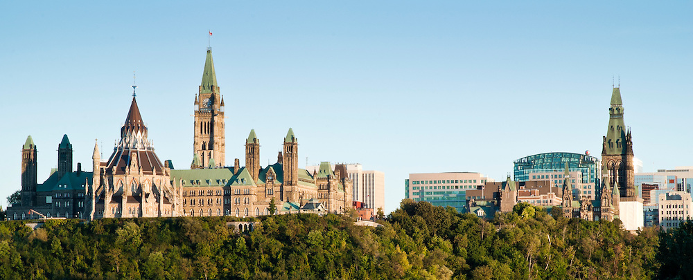 A view of the Government of Canada's Parliament buildings from the Ottawa river shores.