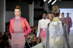 © Licensed to London News Pictures. 03/06/2018. LONDON, UK.  A model presents a look by Kate Avery from Falmouth University on the opening day of Graduate Fashion Week taking place at the Old Truman Brewery in East London.  The event presents the graduation show of up and coming fashion designers from UK and international universities.  Photo credit: Stephen Chung/LNP