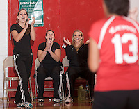 Varsity Volleyball head coach Mollie Babcock, assistant coach Mary Ann Myers and JV coach Krystal Diorio cheer on their girls during match play with the Gilford Eagles Tuesday evening.  (Karen Bobotas/for the Laconia Daily Sun)