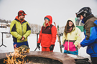 MacKenzie Ryan, Jack, Avie, and local warm by the outdoor fire at the Giant Steps Lodge after riding at Brian Head, Utah.