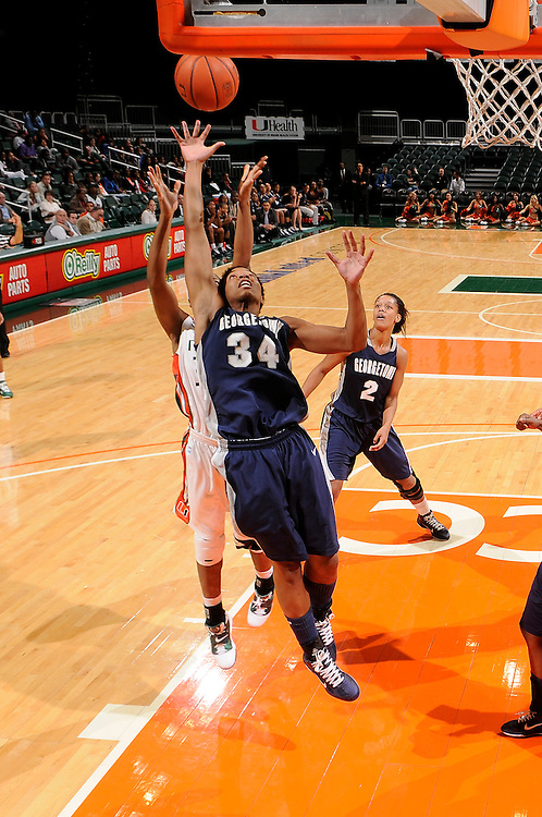 December 7, 2010: Alexa Roche of the Georgetown Hoyas reaches over Sylvia Bullock of the Miami Hurricanes for a rebound during the NCAA basketball game between Georgetown and Miami. The 'Canes defeated the Hoyas 81-72.