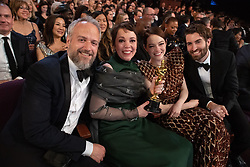 Olivia Colman (2nd from L), Oscar® winner, poses with Ed Sinclair (L), Emma Stone, and Dave McCary pose during the live ABC Telecast of The 91st Oscars® at the Dolby® Theatre in Hollywood, CA on Sunday, February 24, 2019.