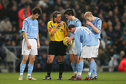 MANCHESTER, ENGLAND - WEDNESDAY, JANUARY 4th, 2006: Manchester City's Joey Barton prepares to take a free-kick as referee Alan Wiley gives him instructions during the Premiership match against Tottenham Hotspur at the City of Manchester Stadium. (Pic by David Rawcliffe/Propaganda)