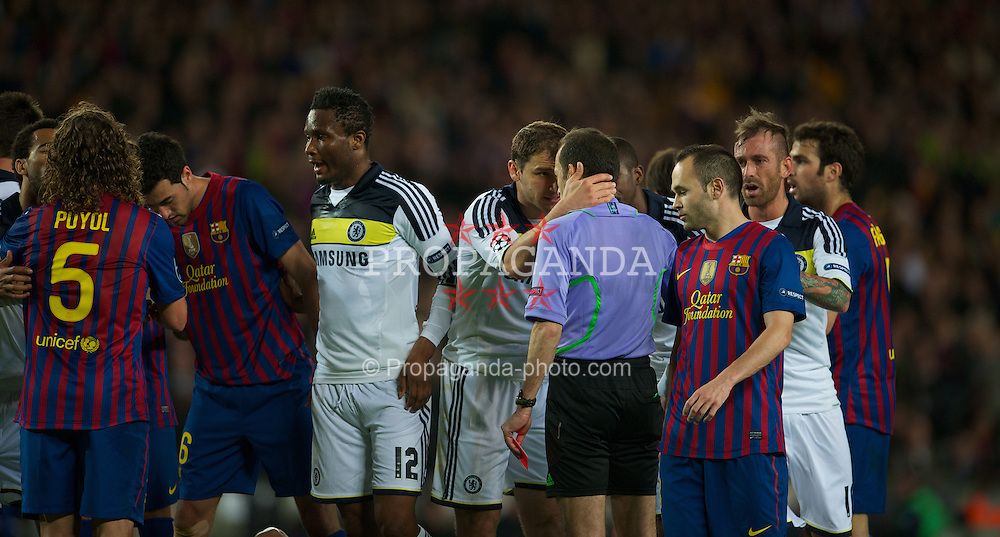 BARCELONA, SPAIN - Tuesday, April 24, 2012: Chelsea's Branislav Ivanovic tries to pursued referee Cuneyt Cakir to change his mind after John Terry is sent off during the UEFA Champions League Semi-Final 2nd Leg match against FC Barcelona at the Camp Nou. (Pic by David Rawcliffe/Propaganda)
