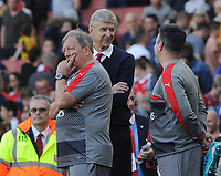 Football - 2016 / 2017 Premier League - Arsenal vs. Everton<br /> <br /> Arsenal Manager Arsene Wenger watches from the tunnel with Vic Akers as his players walk round the ground after failing to qualify for the Champions League after the match at The Emirates.<br /> <br /> COLORSPORT/ANDREW COWIE