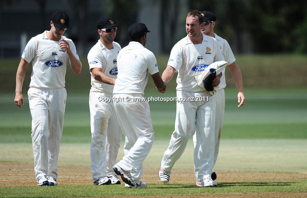 Wellington's Mark Gillespie is congratulated by team mates after a man of the match performance during the Ford Trophy Cricket match between Auckland and Wellinton at Colin Maiden Oval in Auckland, New Zealand on Monday 27 February 2012. Photo: Andrew Cornaga/Photosport.co.nz