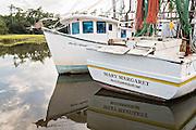 Shrimp boats tied up at the docks along Jeremy Creek in the village of McClellanville, South Carolina.