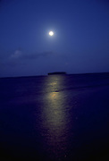 Moonrise over motu (island), Raiatea, French Polynesia<br />