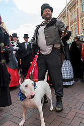 © Licensed to London News Pictures. 03/12/2016. Rochester, UK. A man dresses as Bill Sykes from Oliver Twist as participants take part in the Rochester Dickensian Christmas Festival.  The Kent town is given a Victorian makeover to celebrate the life of the writer Charles Dickens (who spent much of his life there), with Victorian themed street entertainment, costumed parades and a Christmas market. Photo credit : Stephen Chung/LNP