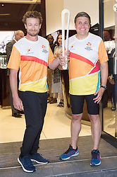 August 16, 2017 - London, London, UK - London, UK. Longines Ambassador of Elegance Simon Baker (L) and Longines Vice President of Marketing Juan-Carlos Capelli ( R) hold The 2018 Commonwealth Games Queen's Baton at the Longines Botique in London. The Queen's Baton Relay began its journey in Buckingham Palace earlier this year and is now travelling through 71 nations or territories of the Commonwealth, covering 230'000 kilometres. (Credit Image: © Ray Tang/London News Pictures via ZUMA Wire)