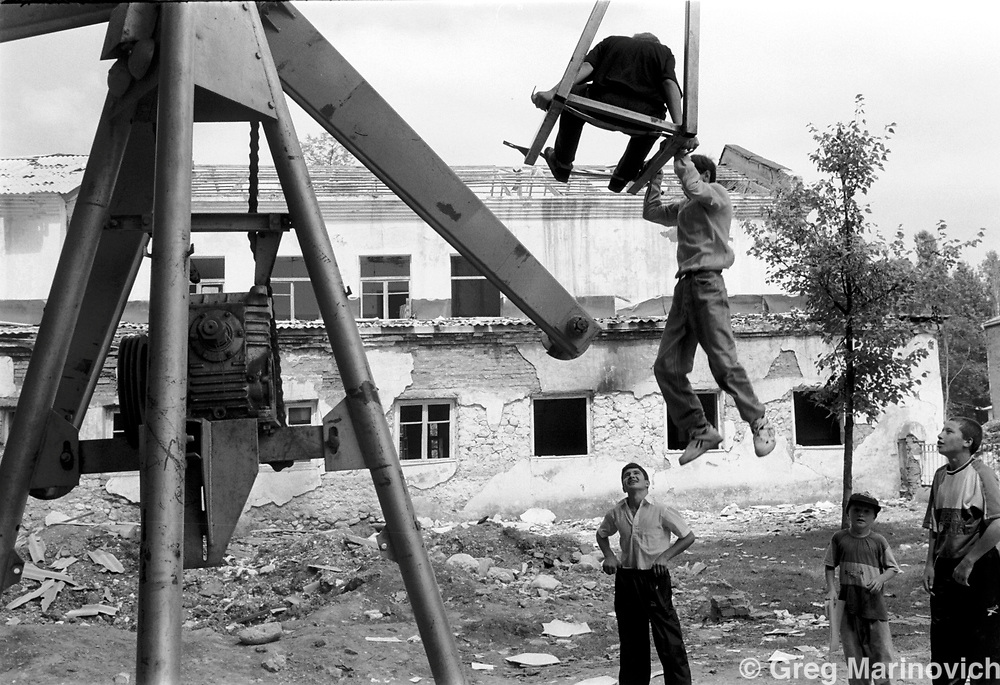 Playground in bombed centre of Vedeno, Chechnya, 1995. Greg Marinovich