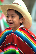 Performer age 7 in native dress at Cinco de Mayo Festival.  St Paul Minnesota USA