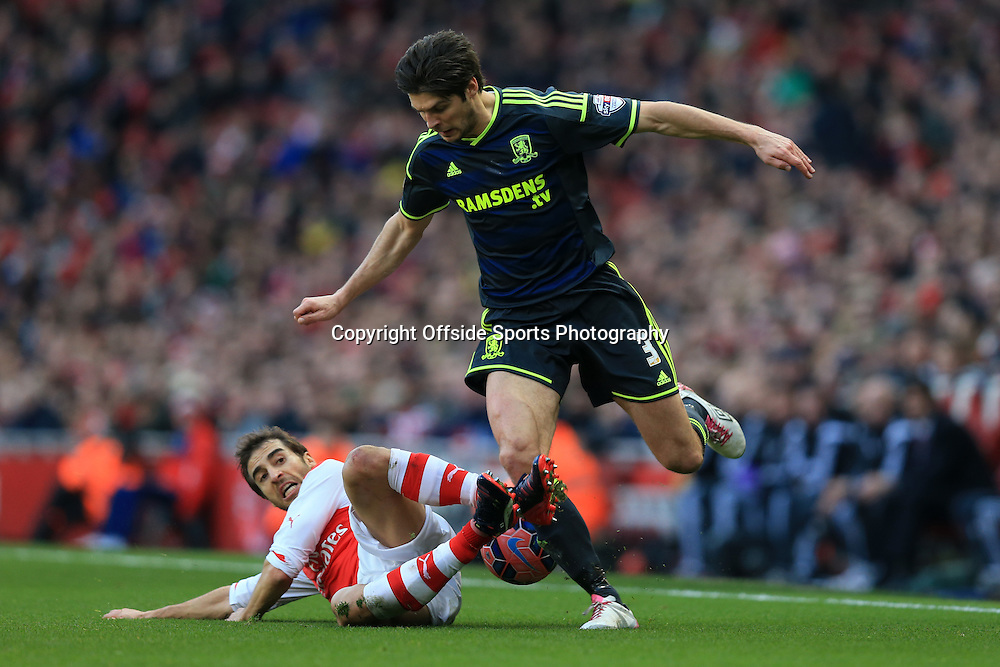 15 February 2015 - The FA Cup Fifth Round - Arsenal v Middlesbrough - George Friend of Middlesbrough in action with Mathieu Flamini of Arsenal - Photo: Marc Atkins / Offside.