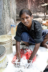 Woman washing her clothes on the street in Chennai, India. Photo taken while traveling in Rajasthan, India, with Steve McCurry.