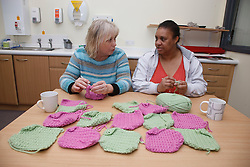 Women doing crochet. Cleared for Mental Health issues.