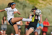 Grace Brethren's Amanda Stout, right, tries to avoid the foot of Sierra Canyon's Avia Jacobs during the CIF State Division 5 Southern California regional final on March 14, 2015 at Sierra Canyon School in Chatsworth.