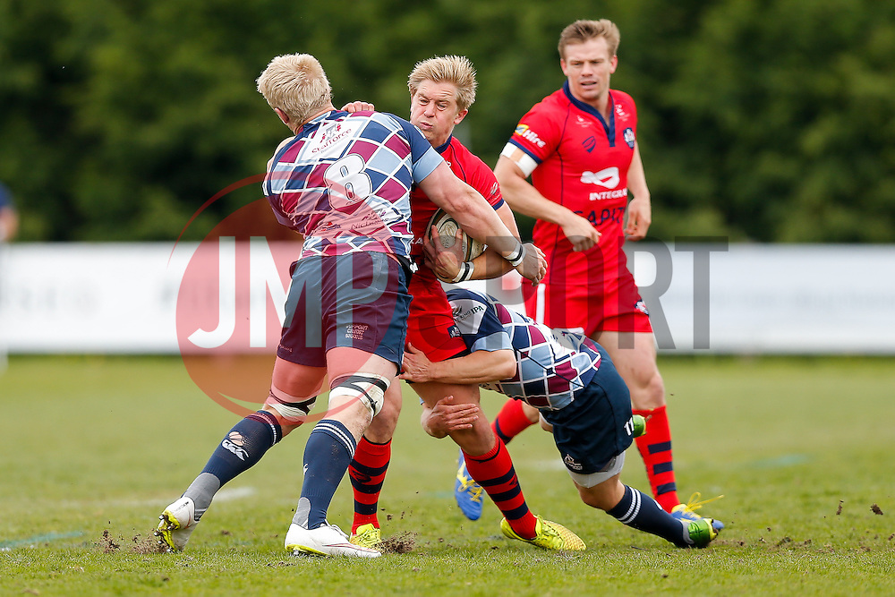 Bristol Rugby Winger Charlie Amesbury is tackled by Rotherham Titans Number 8 Ben Morris and Winger Jamie Broadley - Photo mandatory by-line: Rogan Thomson/JMP - 07966 386802 - 10/05/2015 - SPORT - RUGBY UNION - Abbeydale Park, Sheffield - Rotherham Titans v Bristol Rugby - Greene King IPA Championship Play Off Semi Final Second Leg.