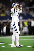 Dallas Cowboys quarterback Dak Prescott (4) flexes his biceps and laughs during the NFL week 13 regular season football game against the New Orleans Saints on Thursday, Nov. 29, 2018 in Arlington, Tex. The Cowboys won the game 13-10. (©Paul Anthony Spinelli)