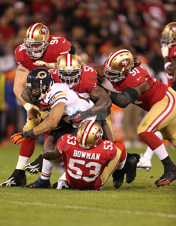 Chicago Bears running back Matt Forte (22) is tackled by San Francisco 49ers linebacker Patrick Willis (52), during an NFL game on Monday Nov. 19, 2012 in San Francisco, CA.  (photo by Jed Jacobsohn)