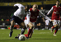 Photo: Paul Thomas.<br /> Tottenham Hotspur v Arsenal. Calring Cup, Semi Final 1st Leg. 24/01/2007.<br /> <br /> Jermain Defoe of Spurs (L) triues to fight off Phillipe Senderos