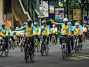 11 DECEMBER 2015 - BANGKOK, THAILAND: People ride in the Bike for Dad bike ride in central Bangkok. More than 527,000 people registered for the Bike for Dad event to honor Bhumibol Adulyadej, the King of Thailand, whose birthday is also celebrated as Father's Day in Thailand. In Bangkok, 99,999 people registered for Bike for Dad. More than 418,000 people registered for Bike for Dad rides in the provinces outside Bangkok and 9,805 participated in Bike for Dad events outside of Thailand. His Royal Highness Crown Prince Maha Vajiralongkorn, the heir apparent to the Thai crown, led the bike ride in Bangkok. The Bangkok route was 29 kilometers long (18 miles) and traveled through Bangkok and across the Chao Phraya River into Thonburi. Bike for Dad events were held across Thailand.     PHOTO BY JACK KURTZ