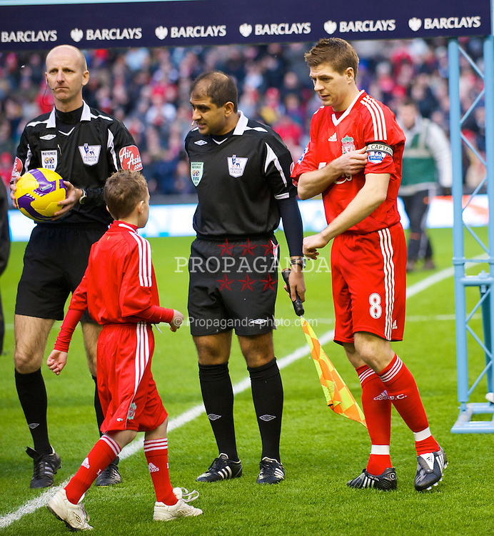 LIVERPOOL, ENGLAND - Sunday, February 1, 2009: Liverpool's captain Steven Gerrard MBE with the match-day mascot before the Premiership match against Chelsea at Anfield. (Mandatory credit: David Rawcliffe/Propaganda)