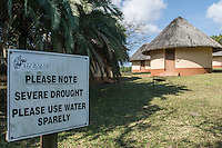 A sign indicating a severe drought and request to use water sparringly, iSimangaliso Wetland Park, KwaZulu Natal, South Africa