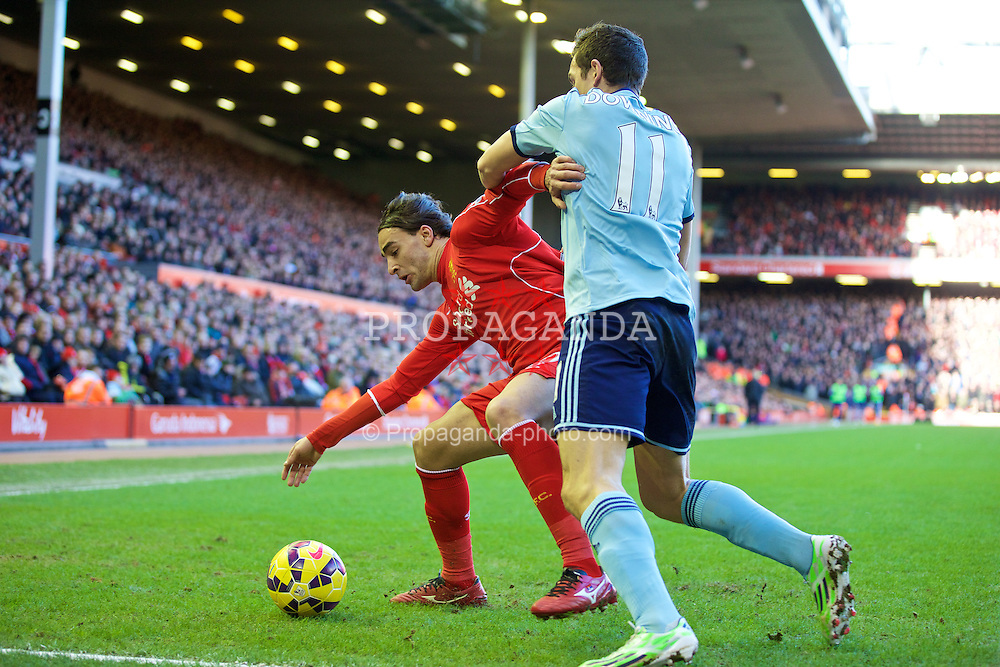 LIVERPOOL, ENGLAND - Saturday, January 31, 2015: Liverpool's Lazar Markovic in action against West Ham United's Stewart Downing during the Premier League match at Anfield. (Pic by David Rawcliffe/Propaganda)