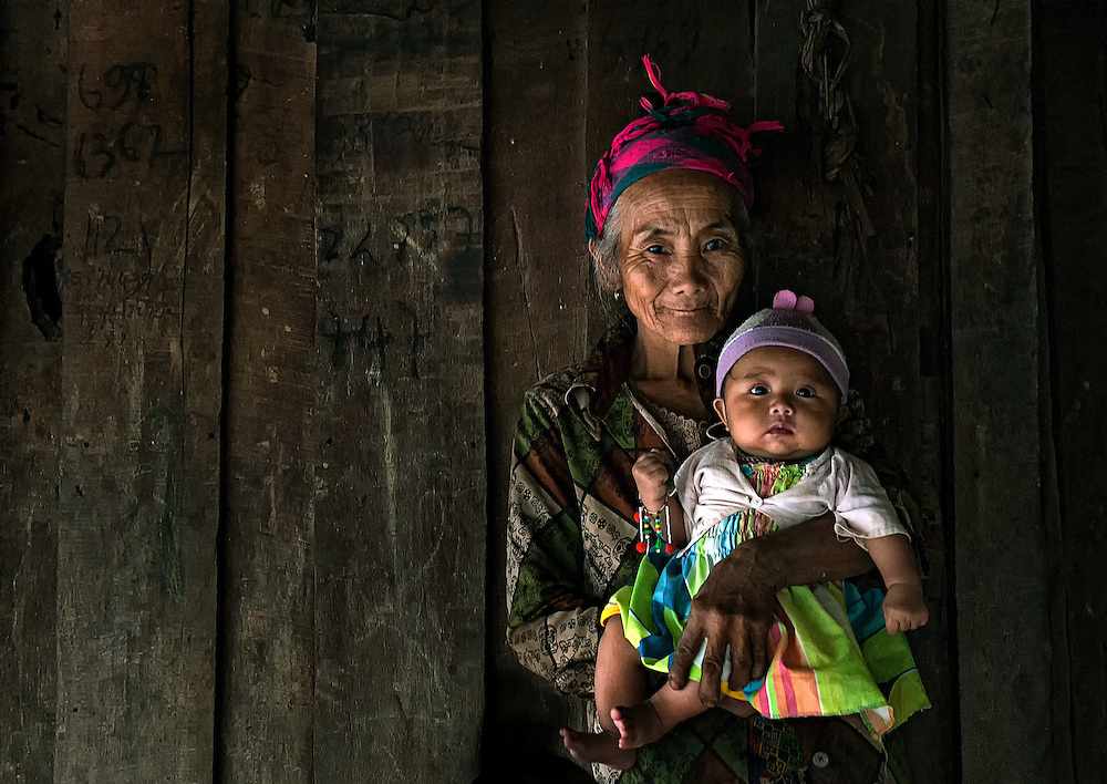 A Hmong grandmother and child in a mountain village near Luang Prabang, Laos.