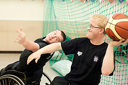 Cadbury 2012 Paralympic demonstration Sheffield.Alex Hammond and Mike Porter Player with the RGK Rhinos Sporting club wheelchair basketball team to give Sheffield colleagues an insight into Wheelchair basketball, Paralympic sports and promote awareness around the different sporting disciplines.   .  ....3 September 2012.Image © Paul David Drabble