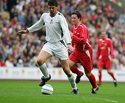 LIVERPOOL, ENGLAND - SUNDAY MARCH 27th 2005: Liverpool Legends' Robbie Fowler and Celebrity XI's Naill Quinn during the Tsunami Soccer Aid match at Anfield. (Pic by David Rawcliffe/Propaganda)