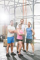 Portrait of confident people standing at crossfit gym