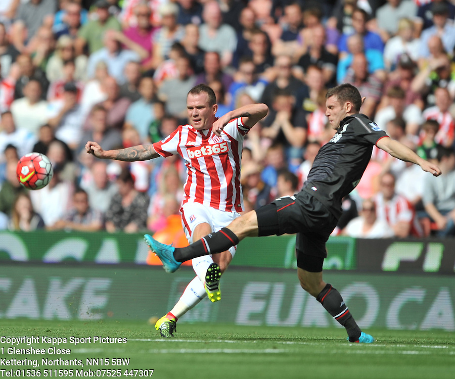 LIVERPOOL JAMES MILNER HOLDS OF STOKE Stoke City v Liverpool, Premiership, Britannia Stadium Sunday 9th August 2015