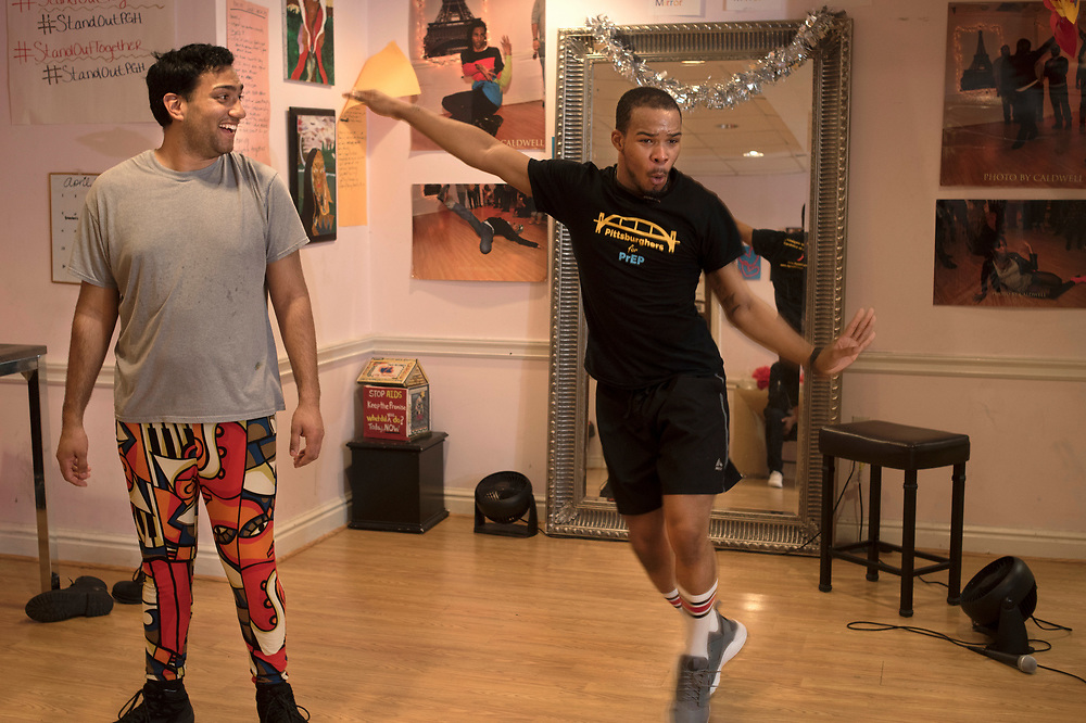 Roi Johnson (right) introduces Salim Snyder (right) the basics of voguing during a weekly vogue workshop at Project Silk in downtown Pittsburgh. Voguing is characterized by model-like poses integrated with angular, linear, and rigid arm, leg, and body movements.