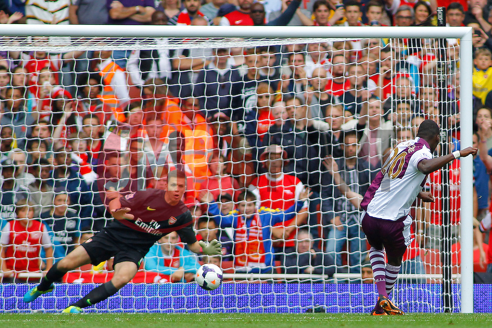 Aston Villa's Christian Benteke scores a goal past \Arsenal's Wojciech Szczesny   - Photo mandatory by-line: Mitch Gunn/JMP - Tel: Mobile: 07966 386802 17/08/2013 - SPORT - FOOTBALL - Emirates Stadium - London -  Arsenal V Aston Villa - Barclays Premier League