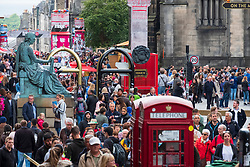 Edinburgh, Scotland, UK. 27 August, 2018. On the final day to of The Edinburgh Fringe Festival 2018, the Royal Mile is still very busy with tourists enjoying the live street performers.