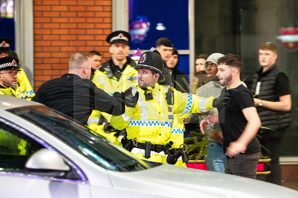 """© Licensed to London News Pictures . 22/12/2018 . Manchester , UK . Police intervene after a fight breaks out outside The Birdcage nightclub on Withy Grove . Revellers out in Manchester City Centre overnight during """" Mad Friday """" , named for historically being one of the busiest nights of the year for the emergency services in the UK . Photo credit : Joel Goodman/LNP"""