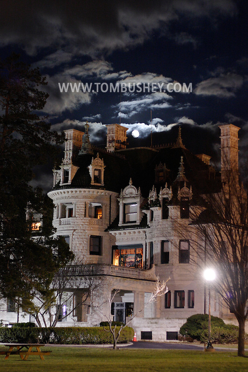 Middletown, N.Y. - The full moon illuminates the clouds above Morrison Hall on the campus of Orange County Community College on March 14, 2006. The 40-room mansion, which is now used for offices, features a large stained glass window designed by Louis Comfort Tiffany.