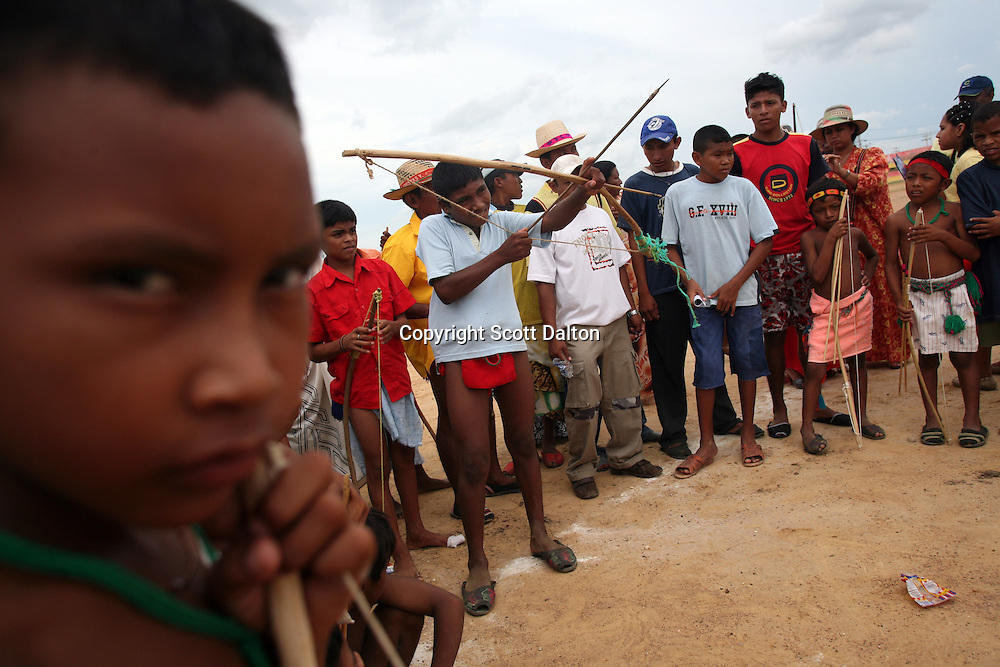 Wayuu Indian boys compete in a traditional archery competition that is part of the annual Wayuu Cultural Festival in Uribia, Colombia June 10, 2007. (Photo/Scott Dalton)