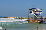 Israel, Haifa, Carmel Beach, Israelis go to the Beach on a warm, sunny day - the lifeguard station