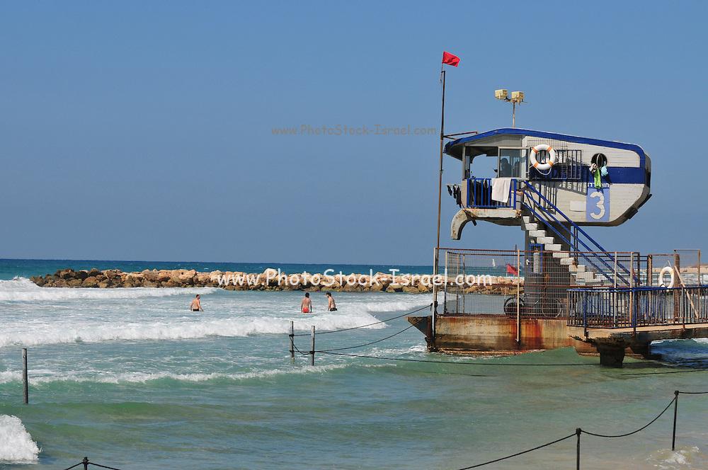 Israel, Haifa, Carmel Beach, Israelis go to the Beach on a warm, sunny day - the lifeguard station