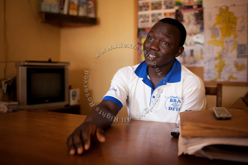 Austin Jang, 26, a social development worker in the Christian-dominated neighbourhood of Kabong, Jos, Plateau State, Nigeria. Austin is part of the 'Early Warning Team' of Jos, meant to facilitate communication, awareness and reconciliation, in order to prevent further violence between local communities of Christian and Islamic faith.