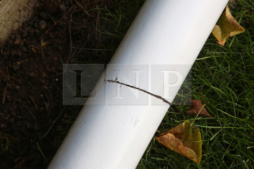 © Licensed to London News Pictures. 23/11/2015. London, UK.  A vandalised flag pole at the Australian Military Cemetery next to St Mary's Parish Church in Harefield. Vandals had attempted to saw through the flagpole. Photo credit: Peter Macdiarmid/LNP