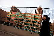 12th grader Brander Suero, walks past Central Park East High School after buying lunch in Harlem, New York, NY on November 15, 2012. Beyond sheer physical safety, a look at how schools and districts can create classroom conditions in which students are able to engage enthusiastically and without emotional fear of stepping forward. Photographer: Melanie Burford/Prime
