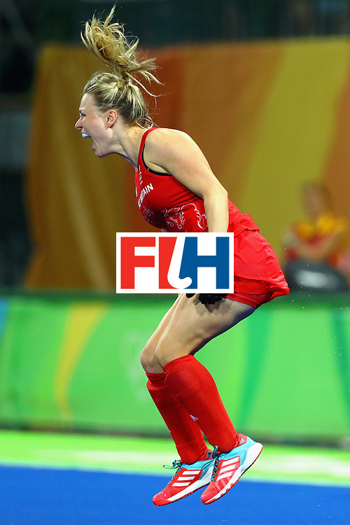 RIO DE JANEIRO, BRAZIL - AUGUST 19:  Hollie Webb of Great Britain celebrates after scoring the winning penalty against the Netherlands during the Women's Gold Medal Match on Day 14 of the Rio 2016 Olympic Games at the Olympic Hockey Centre on August 19, 2016 in Rio de Janeiro, Brazil.  (Photo by Tom Pennington/Getty Images)