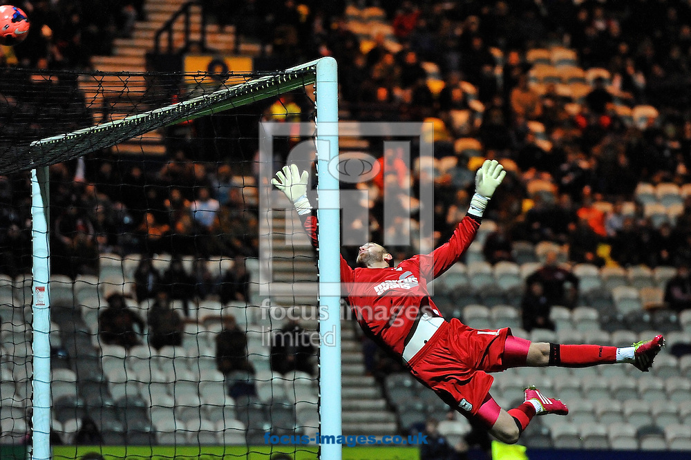 Picture by Ian Wadkins/Focus Images Ltd +44 7877 568959<br /> 14/01/2014<br /> Scott Loach of Ipswich Town tips the ball over during the The FA Cup match at Deepdale, Preston.